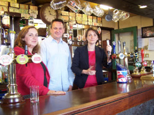 Eluned Parrott AM, Councillor Nigel Howells and Kirsty Williams AM in the Vulcan Hotel